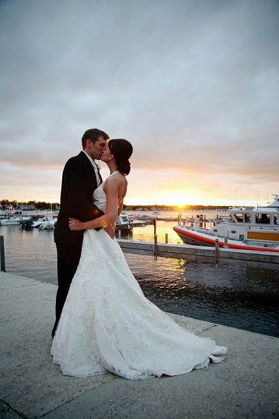 Bride and groom kiss at the Lodge at Leathem Smith's marina in Sturgeon Bay, WI.