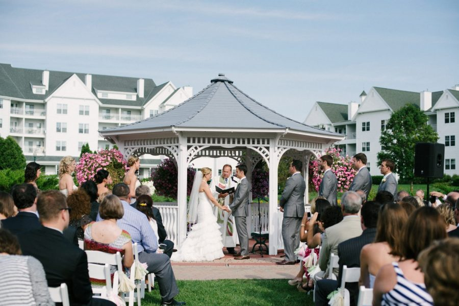 Wedding ceremony at gazebo on the grounds of the Osthoff Resort