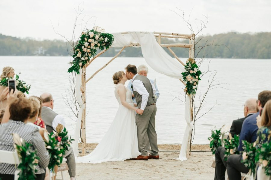 Wedding ceremony on the beach at the Osthoff Resort in Elkhart Lake, WI
