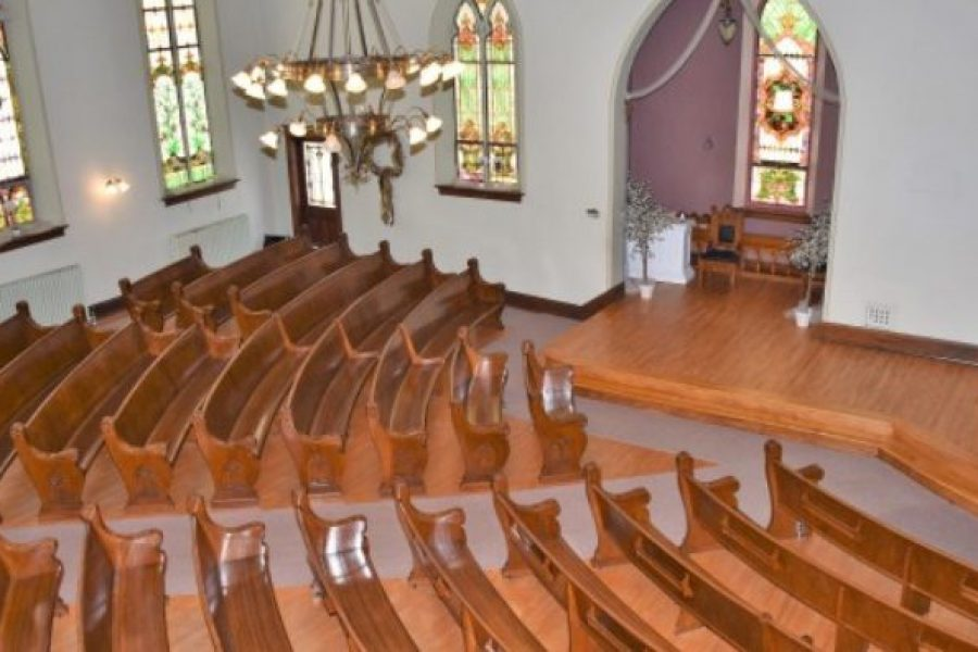 Classic Chapel seating at Devotions Wedding Chapel located in Green Leaf, WI