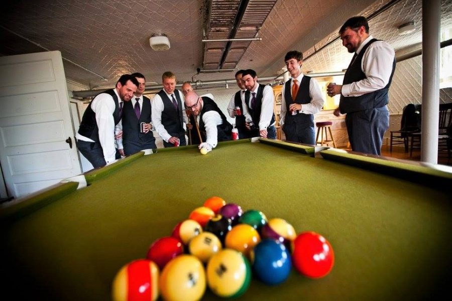 Grooms playing pool