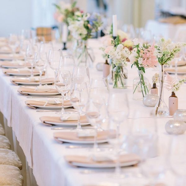 Elegant head table at a Delta Hotels by Marriott Green Bay wedding