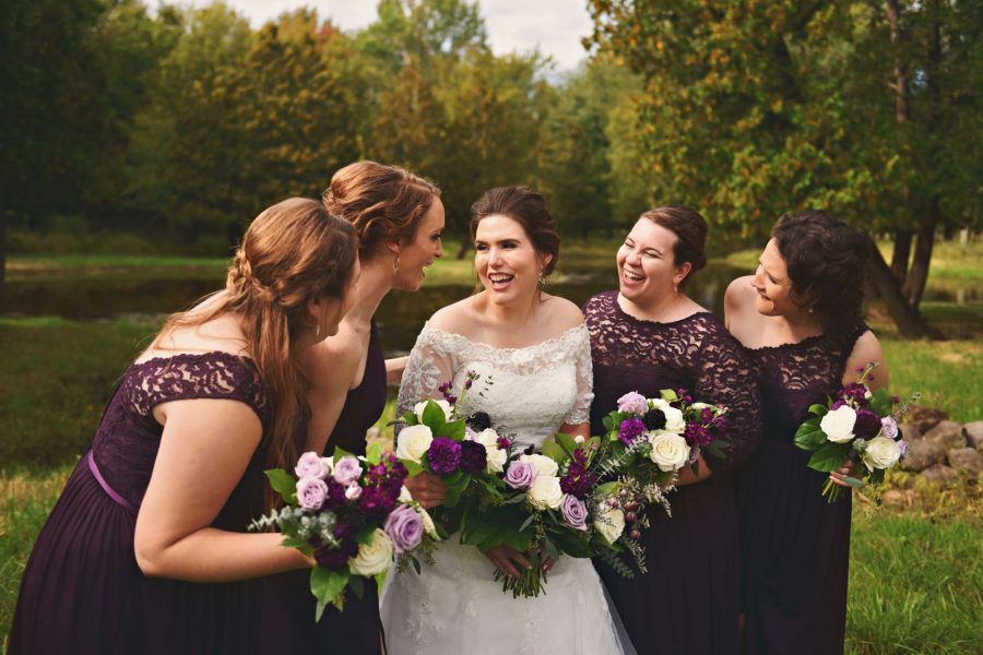 bride and her bridesmaids laugh- bouquets by 88 Events