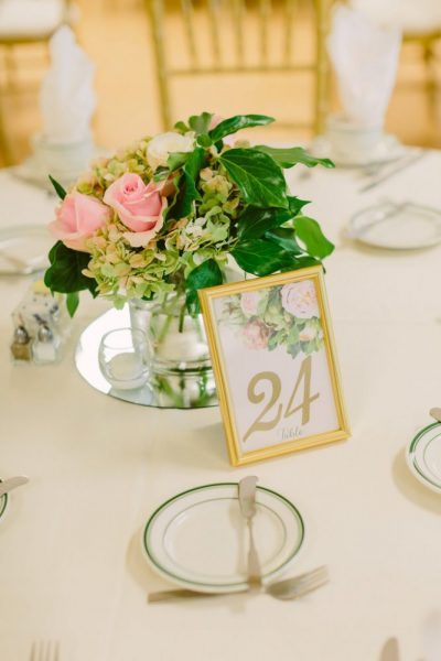 Floral accented table number in gold frame