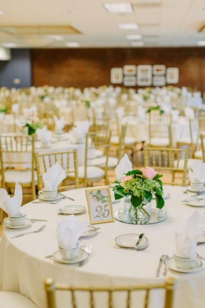 Wedding reception with gold chivaree chairs at St. Norbert College | The Bemis Conference Center & Michels Ballroom