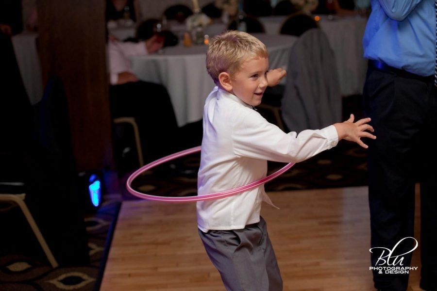 Child on the dance floor with hula hoop- Record Entertainment