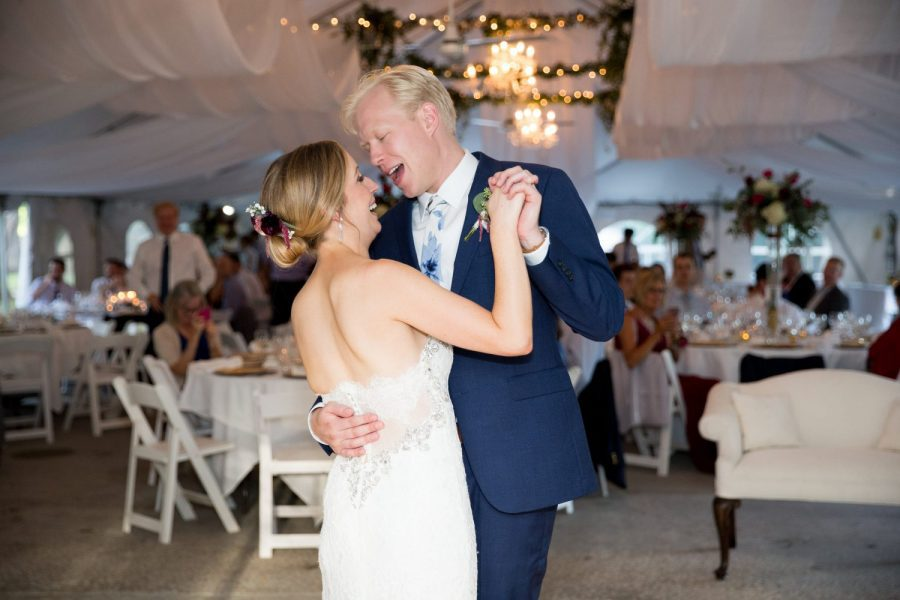 Bride and groom dance at elegant tented wedding reception- Record Entertainment
