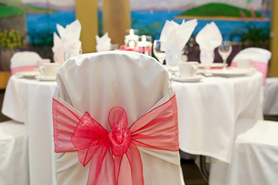 Chair covers liven up the look at this wedding reception