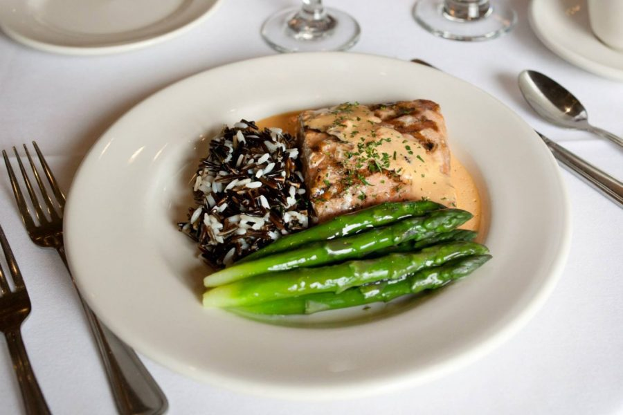 Salmon plated entree with asparus