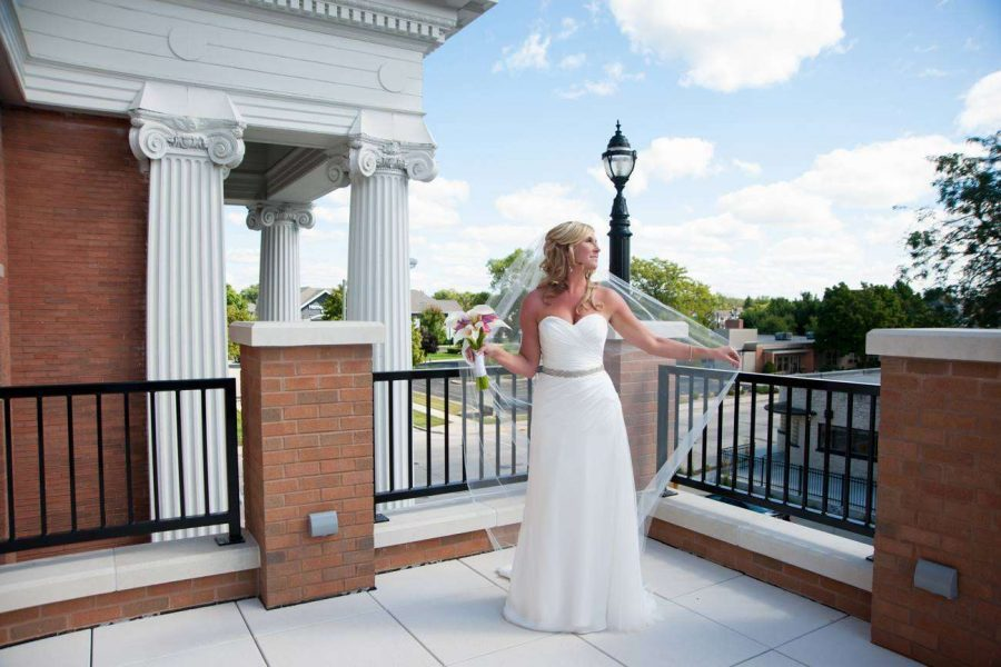 Bride posing on the balcony of the Thelma Sadoff Center for the Arts in Fond du Lac