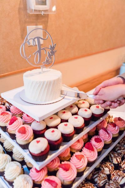 Elegant Cupcake display with classic white cake on top | Cupcake Couture