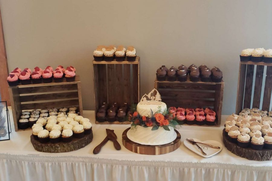 Rustic cupcake display with wedding cake by Cupcake Couture in De Pere, WI