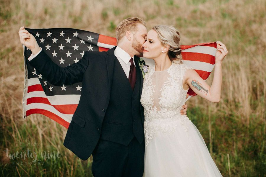 Bride and groom with flag