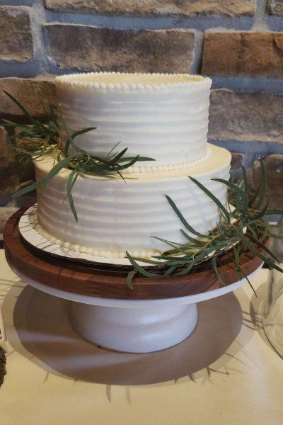 Elegant white wedding cake by Cupcake Couture