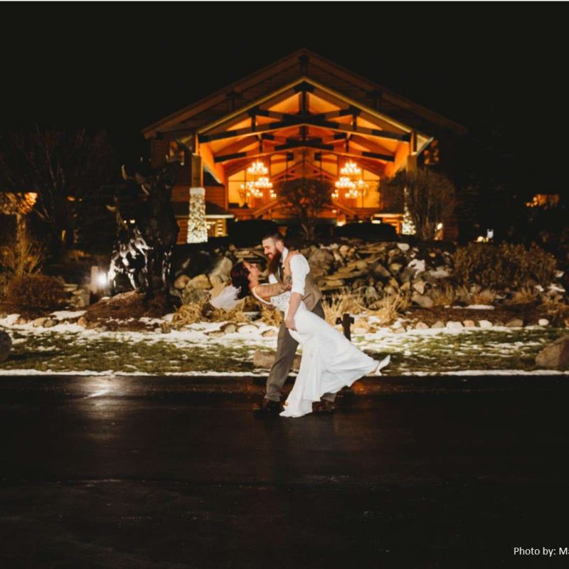 Bride and groom outside of Tundra Lodge