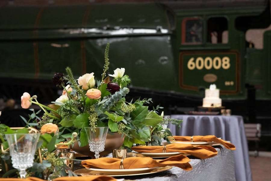 Elegant table setting at a National Railroad Museum wedding reception