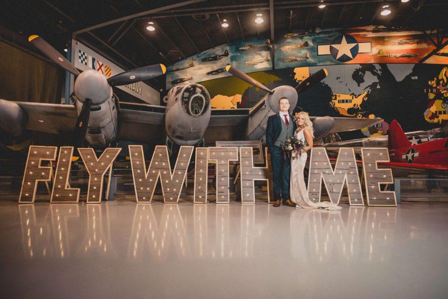 Bride & Groom at their EAA Aviation Center wedding in Oshkosh