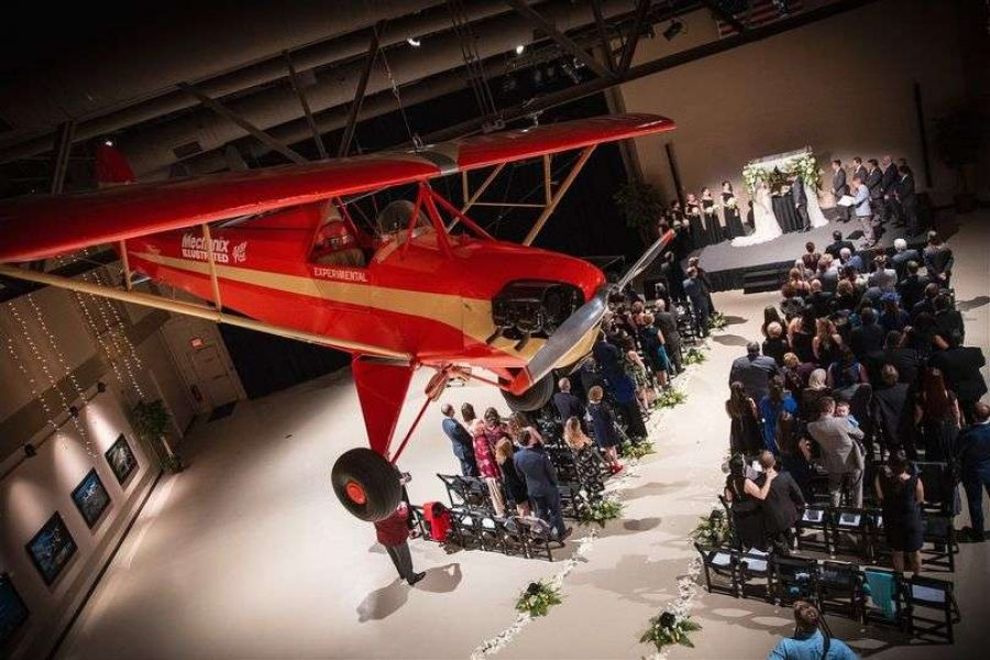 Wedding ceremony in the Eagle Hangar at the EAA Aviation Center in Oshkosh, WI