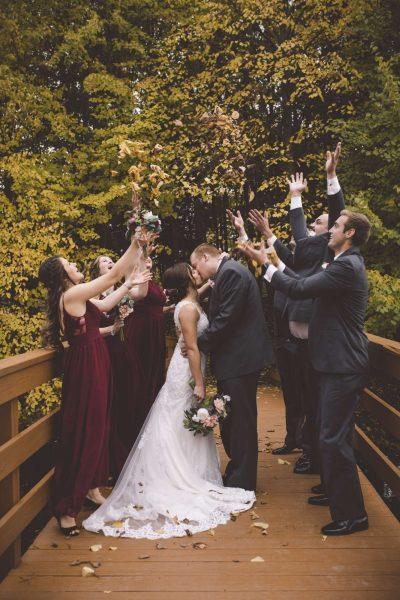 Wedding party on walk bridge at the EAA Center in Oshkosh, WI