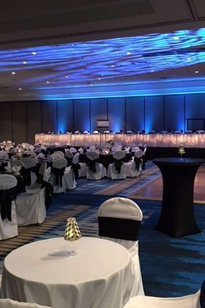 Blue up-lights at Radisson Green Bay wedding reception