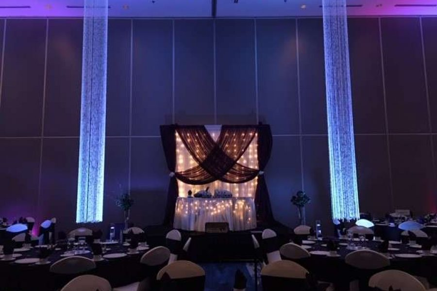 Lit sweetheart table at Radisson Hotel and Conference Center wedding in Green Bay