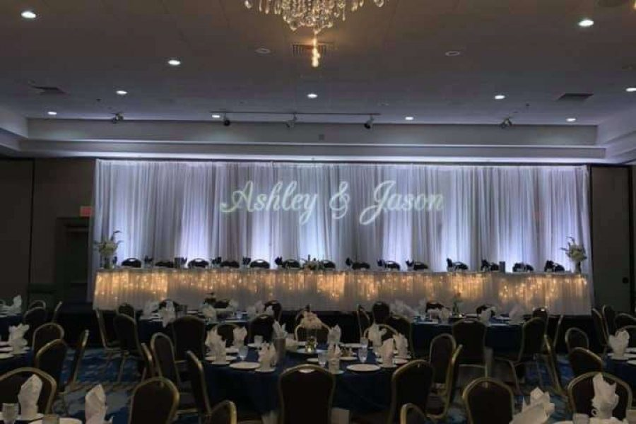 Elegant wedding celebration at the Lit sweetheart table at Radisson Hotel and Conference Center wedding in Green Bay