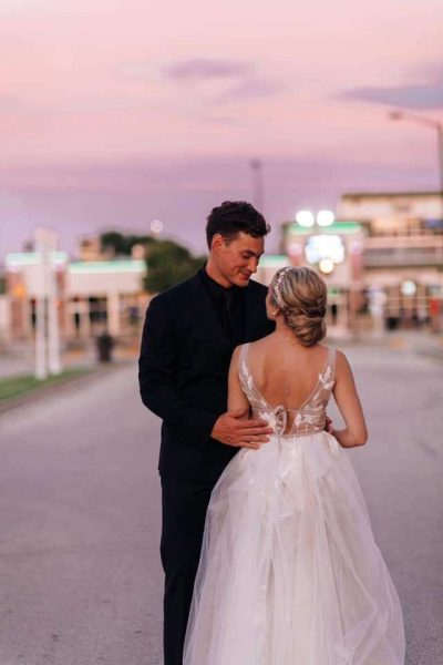 Bride and groom outside of Stadium View in Green Bay, WI