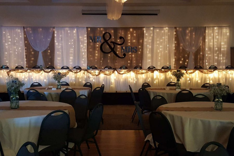 La Sure's Banquet Hall weddings- Head Table with draping and lighting
