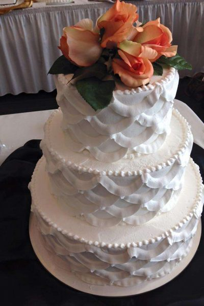 La Sure's Hall Banquet & Catering Custom designed wedding cake with fresh floral accents