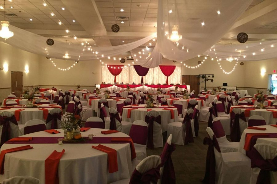 Wedding reception in red and white at La Sure's Hall Banquet & Catering