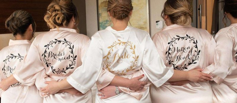 Bride and bridesmaids in personalized robes