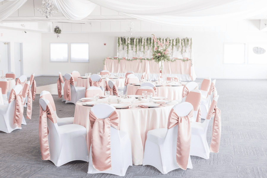 Wedding reception in white and pink at the Par 4 Resort in Waupaca, WI