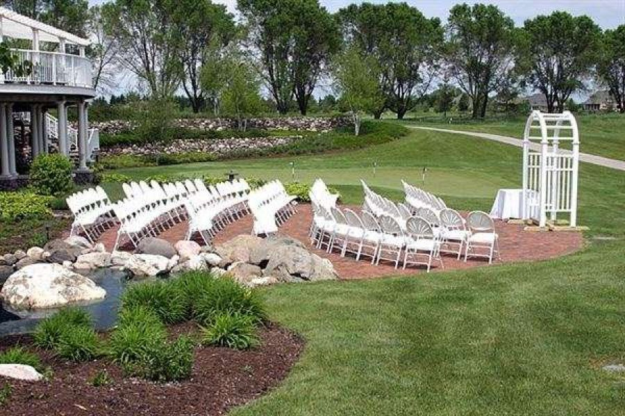 Wedding ceremony set up on the terrace at the Manor at Pinehurst Farms