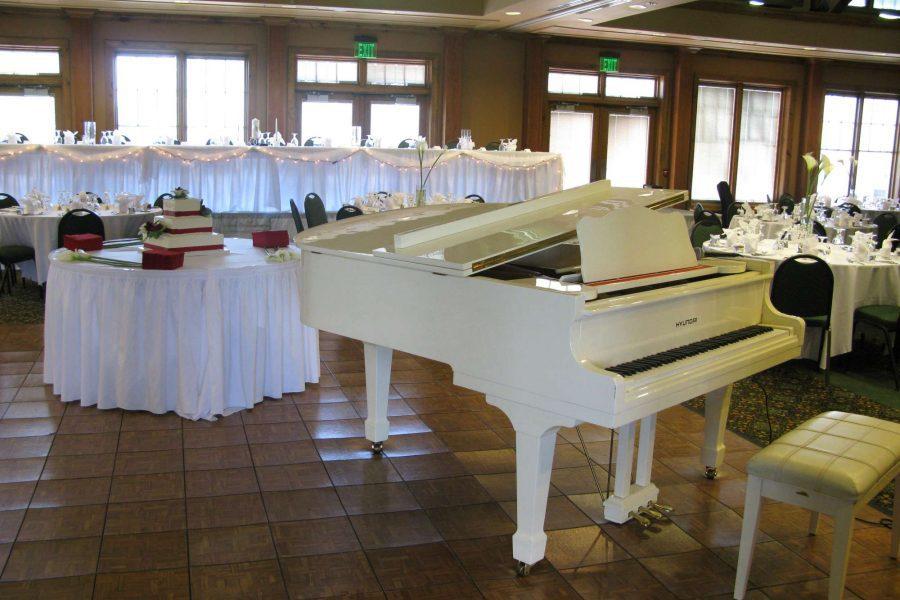 White piano at wedding reception at the Manor at Pinehurst Farms
