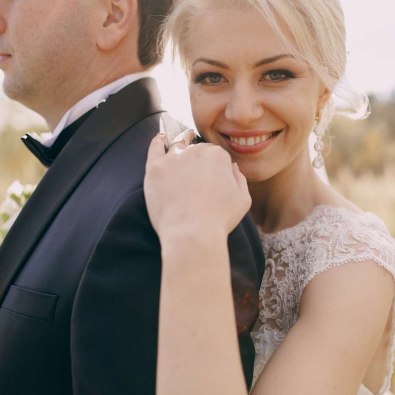 Blonde bride smiles at camera